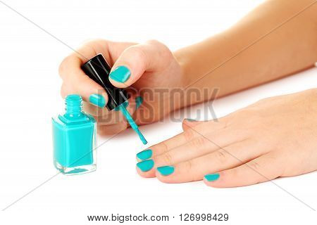 Nail Polish In The Woman Hand On A White Background