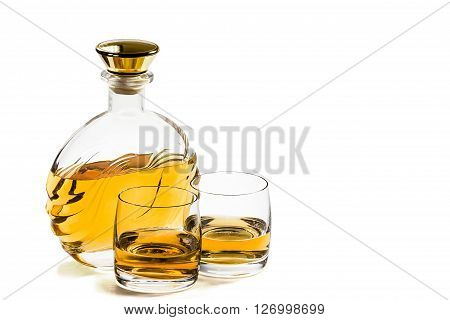 Bottle and two glass of whiskey on a white background ** Note: Visible grain at 100%, best at smaller sizes