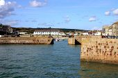 image of safe haven  - the harbor at porthleven cornwall uk on a sunny day - JPG