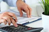 Close Up View Of Bookkeeper Hands Calculating Balance poster