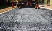 Постер, плакат: Team Of Workers Making And Constructing Asphalt Road Construction
