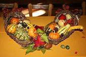 picture of cornicopia  - beautiful fall cornicopia for a table center piece filled with harvest colors and vegetables - JPG