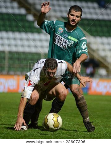 KAPOSVAR, HUNGARY - JULY 30: Pedro Sass (in green) in action at a Hungarian National Championship soccer game - Kaposvar (green) vs Videoton (white) on July 30, 2011 in Kaposvar, Hungary.