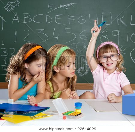 clever children student girl raising hand at school classroom