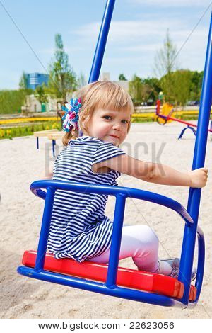 Toddler  girl swinging at the playground