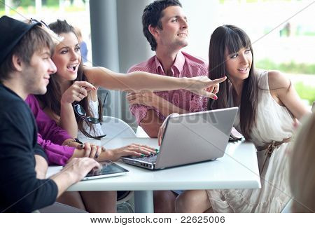 Young people browsing internet on a coffee break