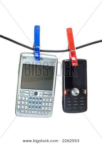 Two Mobile Phones On A Clothes Line