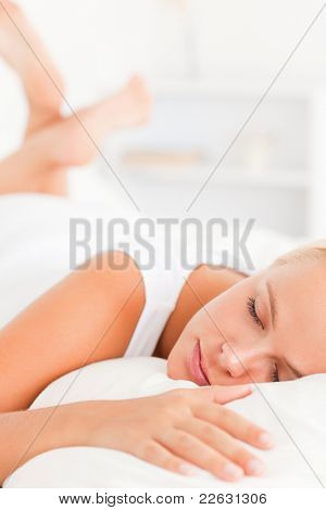 Portrait of a lovely woman sleeping in her bedroom