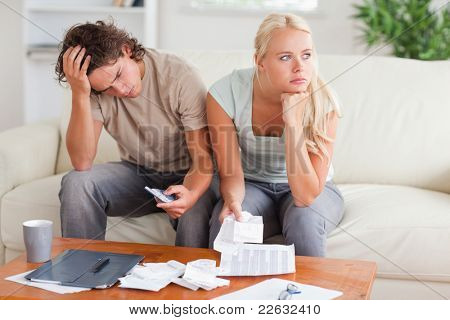 Couple figuring out what to do sitting in the livingroom