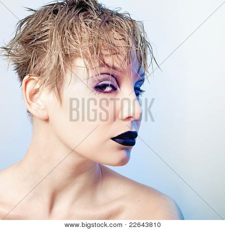 Portrait of young beautiful freaky girl with  stylish makeup