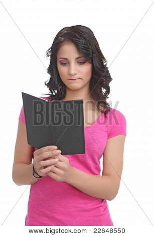 Sad young teen with a book
