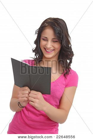 Young teenager with a book laughing