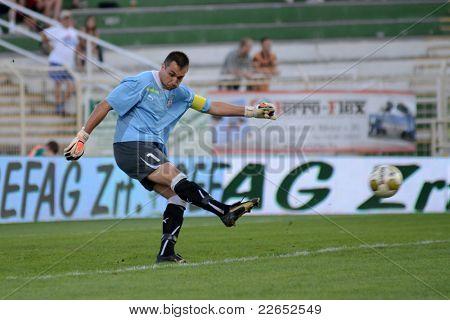 KAPOSVAR, HUNGARY - AUGUST 14: Szabolcs Balajcza (goalkeeper) in action at a Hungarian National Championship soccer game - Kaposvar (green) vs Ujpest (white) on August 14, 2011 in Kaposvar, Hungary.