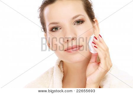 A beautiful woman cleaning her face
