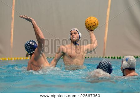 KAPOSVAR, HUNGARY - APRIL 2: Denes Jex (blue 3) in action at a Hungarian national championship water-polo game between Kaposvari VK (white) and AVSE (blue) on April 2, 2011 in Kaposvar, Hungary