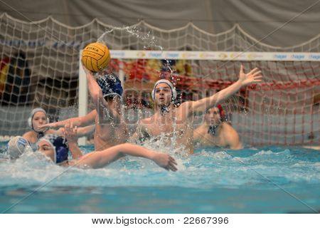 KAPOSVAR, HUNGARY - APRIL 2: Attila Salamon (blue 9) in action at a Hungarian national championship water-polo game between Kaposvari VK (white) and AVSE (blue) on April 2, 2011 in Kaposvar, Hungary