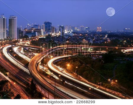 Night city skyline with flyovers