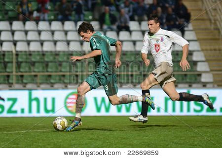 KAPOSVAR, HUNGARY - JULY 30: Milan Peric (in green) in action at a Hungarian National Championship soccer game - Kaposvar (green) vs Videoton (white) on July 30, 2011 in Kaposvar, Hungary.