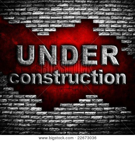 """under construction"" word on brick wall"
