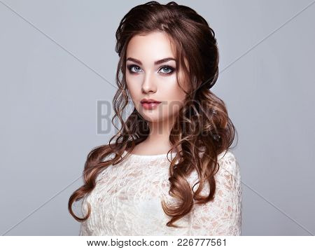 poster of Brunette Woman With Long And Shiny Curly Hair. Beautiful Model Lady With Curly Hairstyle. Care And B