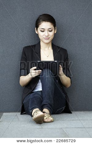 Asian Business Woman Using An Ipad