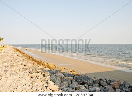 View Down Beach By Rock Seawall