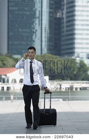 Business Man Walking And Using A Cell Phone