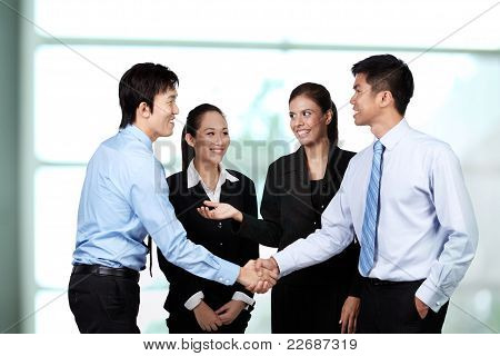 Asian Business men Shaking Hands