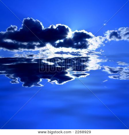 Clouds On Blue Sky Over Water