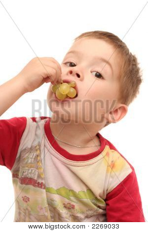 The Boy Eats Tasty Green Grapes