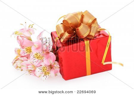 beautiful gift and flowers isolated on white