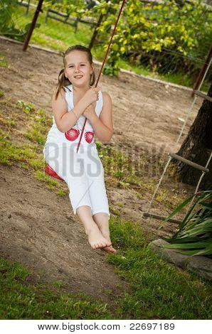 Child Swinging On Seesaw