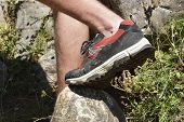 Постер, плакат: Walking Shoes All Terrain Shoes Hiking Shoes On Hiker Outdoors Walking Crossing River Creek Woman