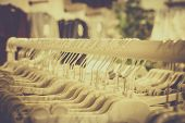 Close Up Clothes Hang On Clothes Rack In Clothing Store With Sweet Tone poster