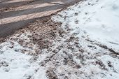 Winter In The City Of Zebra Pedestrian Crossing. Dirty Snow Tracks Auto Car Wheels, Foot Prints Of P poster
