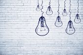 Creative Lamp Sketch On Brick Wall Background. Idea, Innovation And Achievement Concept poster