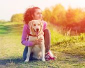 Happy Sporty Woman Rest With Her Dog Golden Retriever. Female Athlete Enjoying Outdoor With Her Pet. poster