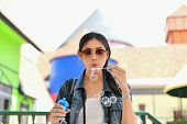 Travel Concepts. Beautiful Girl Is Playing Soap Bubble Fun. Asian Girls Are Relaxing Travels. Asian  poster