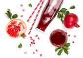 Top View Of Pomegranate Juice In A Bottle And Pomegranate Fruits Isolated On White Background. poster