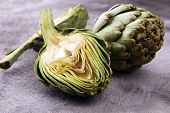 Artichokes On Grey Background. Fresh Organic Artichoke Flower. poster