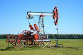 pic of nonrenewable  - Oil Pump Jack in a field pumps petroleum  - JPG