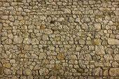 Background Texture Of An Ancient Masonry Of Uneven Gray Stones Closeup poster