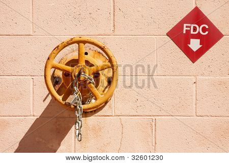 Fire Company Valve On Block Wall