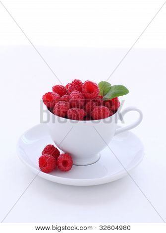 Raspberries in a white cup
