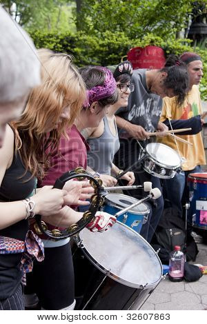 NEW YORK - MAY 1: Drummers gather to form a circle and play during Occupy Wall Street protests on May Day in Union Square on May 1, 2012 in New York, NY.