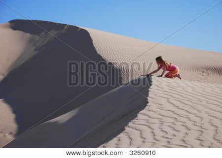 Young Girl Playing On Sand Dunes