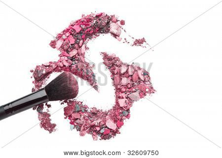crushed eyeshadows mixed with brush isolated on white background