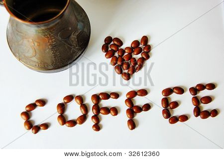copper coffee pot with coffee beans isolated on white