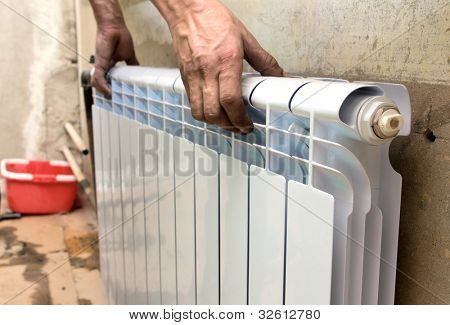 real photo of installation of a radiator