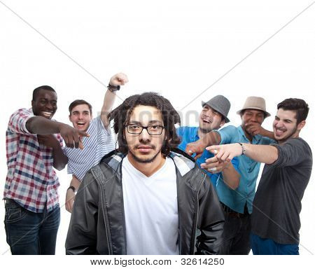 Young group of men who are bullying one of them.